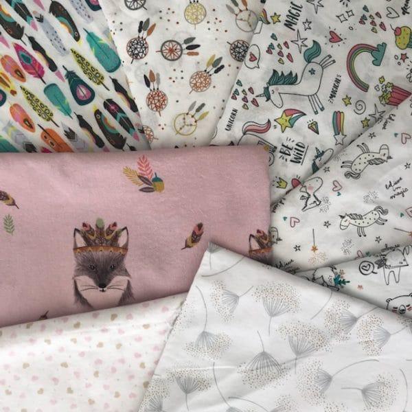 """choix de tissus motifs colorés """"enfants"""" pour atelier de couture"""